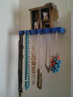 Finally! A necklace rack made from a floating shelf, painted blue, added the leftover hardware from my diy dresser!
