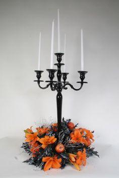 candelabras with flowers at the base   Candelabra & Vase Hire
