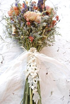 Bridal Bouquet Montana Romance and Lace Brides Bouquet of Dried French Lavender and Blush Peonies, Blue & Pink Larkspur, White Statice, Caspia, Silver and Pale Green Oats  ❤️SHIPPING DETAILS Please consider shipping timing when ordering..This bouquet can ship 2-3 weeks from DATE OF ORDER and will come via USPS PRIORITY MAIL or INTERNATIONAL MAIL and WILL INCLUDE shipping insurance. This bouquet requires a large shipping box.  DESCRIPTION This Pretty and Softly Romantic Bridal Bouquet is m...