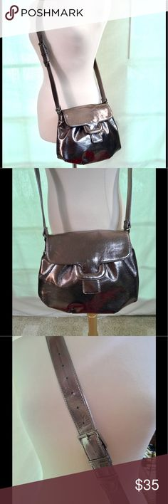 Ecco Silver Leather Crossbody Excellent condition silver leather Crossbody bag by Ecco! Has a magnetic closure and very clean interior. Inside compartments and adjustable length strap. Ecco Bags Crossbody Bags