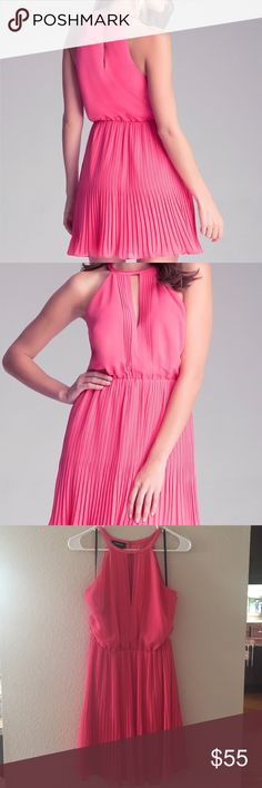 Bebe pleated pink chiffon party dress! This dress is perfect to pack for a vacation dinner! Pretty pink color flatters everyone. High neck with slit in front and back. Elastic waist. Halter style neck. Pleated on bottom. Lined. 100% polyester. Worn once and received a lot of compliments! bebe Dresses Mini