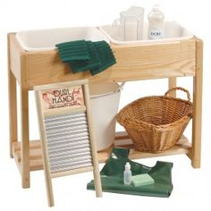 Love this cloth-washing station. I'm debating whether we'd ever have room for it, but maybe if we let it double as a sensory table...