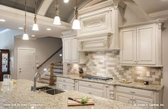 Stunning kitchen with a barrel-vaulted ceiling! The Calypso house plan 1141. #wedesigndreams #dongardnerarchitects