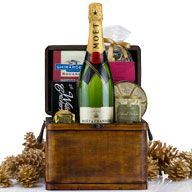 Champagne Treasure: gift basket features Moet Chandon Imperial, some wonderful chocolate treats, Brie cheese and crackers. $119.99