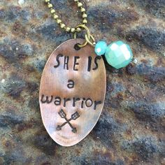 """She is a warrior"" hand stamped necklace ""She is a warrior"" hand stamped pressed Penny necklace with Bohemian blue crystal charm to finish it off. Hangs from 30 inch chain if you have a particular quote that you would like custom orders are welcome Marah Johnson Designs Jewelry Necklaces"