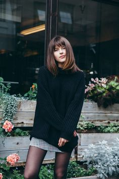 Rima Vaidila is wearing a black knit turtleneck from BDG