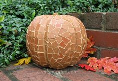 Broken clay pot mosaic on styrofoam pumpkin