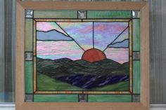 I love the textures and colors in this work.  Mountain Lake Sunset - Delphi Stained Glass