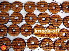 Knock-Off Samoas: Your favorite Girl Scout cookies, made at home! Buttery shortbread cookies dipped in chocolate and covered in a rich coconut caramel!