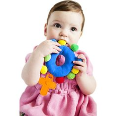A rosary for even the little ones! Brightly colored in primary hues and very soft, this plush toy can reach and teach the little heart of your sweet baby.