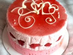 Strawberry Raspberry Mousse Cake with Double Berry Mirror Glaze and Joconde Imprime with White Chocolate Garnish.