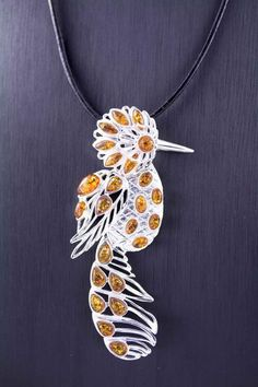 Unique Baltic Amber and Sterling Silver Bird Pendant close up