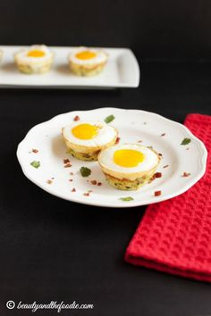 Egg Bacon Zucchini Nests- Easter breakfast. grain free, low carb, & paleo. Grated zucchini nests filled with bacon & egg.