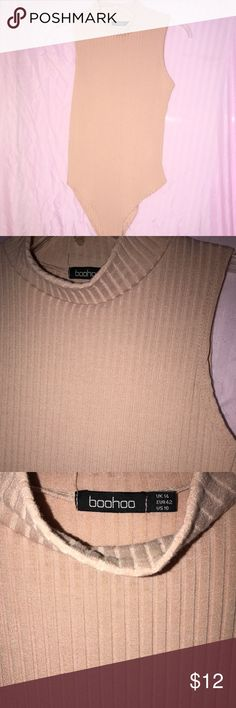 Blush Nude Bodysuit Cotton and stretchy. High neck. No sleeves. Ribbed fabric. Worn once. Tops