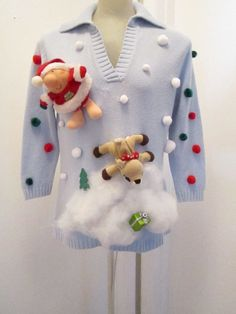 easy. glue on pom poms and stuffed animals on a plain sweater, and the fake snow