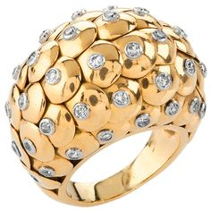 """18 karat gold ring with diamonds. The ring has a 35 round-cut diamonds with an approximate total weight of 1.75 carats. In the style of the Van Cleef & Arpels """"Paillette"""" collection. Circa 1948s"""