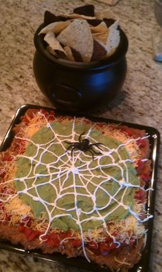 64 Non-Candy Halloween Snack Ideas ~ 5 layer dip with a sour cream spider web!
