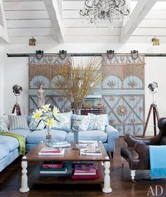 Hill Country House: Design - Thanksgiving Fantasies-Barn door between living and kitchen or dining ideal dor us