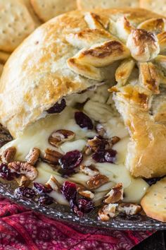 Baked Brie en Croute   www.oliviascuisine.com   A delicious brie cheese covered in puff pastry and filled with honey, cranberries and pecans. Perfect as a Thanksgiving or Christmas appetizer!