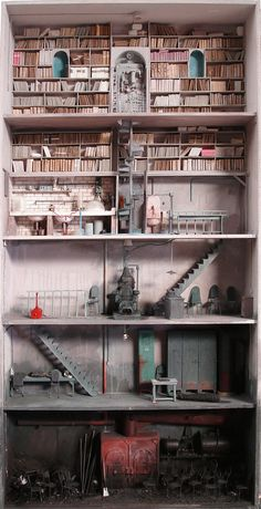 MYSTERIOUS TINY ROOMS BY MARC GIAI-MINIET  French artist Marc Giai-Miniet (Born in 1946 in Trappes) makes some of the most incredibly detailed (and disturbing!) dollhouses that we've ever seen. Marc started creating these disturbing shadowbox dioramas rather late in his career, recurring themes include libraries, furnaces, laboratories, submarines and intestine-like tubing in lonely, decaying spaces.