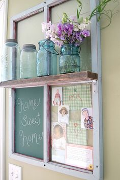 Vintage window frame with memo board and chalkboard.  The shelf with blue mason jars add a light vintage look adding silk or real spring flowers brings the feel of outdoor inside. Great way to keep flowers out of the children's reach and off the countertop clutter