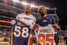 Image may contain: 2 people, people standing National Football League, Nfl, Sports Jerseys, People People, Image, National Soccer League, Nfl Football