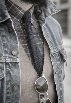 Casual with checked pattern shirt, knitted tie, vest and faded black denim jacket