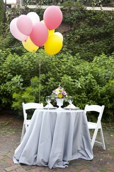 I have also loved the balloon idea since Sara mentioned the Up themed wedding.