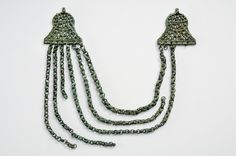"Viking age chain garnish inn bronze, Baltic origin. Instead of beads Baltic women often wore chain garnish across the chest. Grave find from the island of Gotland n the Baltic Sea, Sweden. Object from the exhibition ""We call them Vikings"" produced by The Swedish History Museum."