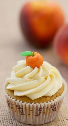 Peach Bourbon Cupcakes - Spiced cupcake studded with Maker's Mark bourbon soaked peaches, stuffed with bourbon peach compote frosted with peach buttercream and garnished with a marzipan peach Gourmet Cupcakes, Cupcake Flavors, Yummy Cupcakes, Cupcake Cookies, Cupcake Recipes, Dessert Recipes, Just Desserts, Delicious Desserts, Yummy Food