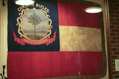 """Corinth Rifles Flag. On February 20, just two days after Jefferson Davis' inauguration, the """"Corinth Rifles"""" was mustered into the army of the newly formed CSA as Co. C, 2nd Regt., 4th Brig. Mississippi Volunteers. On Sunday afternoon, March 10, 1861, the ladies of Corinth presented the unit with a unique and beautiful handmade, 4' x 5'silk flag of the First National design, which had been adopted just six days earlier by the Southern Congress as the first official flag of the Confederacy."""