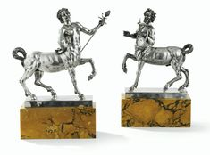 TWO SILVER CENTAURES ON MARBLE BASES, ROME, CIRCA 1900.
