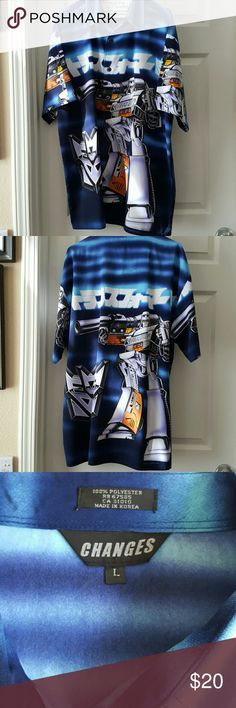 Men's graphic button up Megatron on front and back along with japanese writing.  Purchased from a speciality store and worn only a few times.  In excellent condition! Shirts