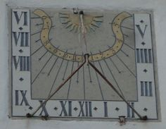 This is an old sundial on the outside wall of the Church in Remmingsheim, Germany, Baden-Württemberg.