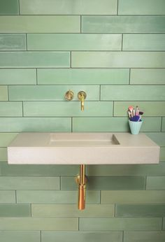 Gorgeous soft lead green tile // 7 ways to green up your bathroom