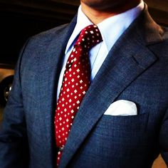 It so often happens that we -- the Lawyers (Dachshund can't type ;-) ) -- feel the need to approve of a style genuinely akin to our profession... Blue/Grey suit -- White/pale blue shirt and red-dotted tie  ...  an ultimate evergreen (try it on with black wingtips for extra acid)