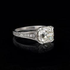 I love this old mine cut diamond ring