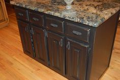 distressed black cabinets