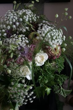 Roses, Queen Anne's lace, geranium leaves, zinnias, grasses & seed pods