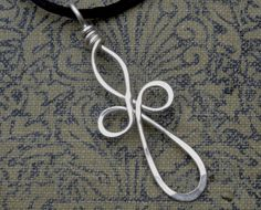 Long Loopy Celtic Cross Silver Wire Pendant- Celtic Cross Necklace - Wire Cross, First Communion, Confirmation Gift Jewelry. $15.50, via Etsy.