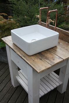 Very cool unit all plumbed in and ready to go! Could be used in a bathroom or perhaps a bootroom if you have one! We upcycled reclaimed wood to make the table top and made some of our own rustic taps to give it that industrial edge! Bathroom Sink Units, Downstairs Bathroom, Belfast Sink Bathroom, Free Standing Sink Bathroom, Small Bathroom Ideas On A Budget, Small Bathrooms, Budget Bathroom, Copper Taps, Outdoor Sinks