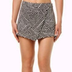 Buffalo David Bitton Asymmetric Black/White Skort Black and white geo stripe print, asymmetrical skort. Zipper in back. New with tags from Buffalo David Bitton. Size Medium. 97% polyester, 3% spandex Buffalo Shorts Skorts