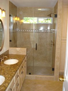 This is the finished Carmichael bathroom.  We re-sized the windows, installed a new large shower, new granite, new tile floor, and new lighting.  The 'frameless' shower door highlights the bathroom.