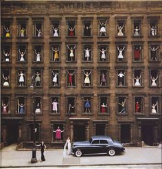 NYC. Girls in the Windows, 1960. Ormond Gigli dreamed up this photo when he realized a brownstone across from his New York apartment was being demolished. He quickly organized 43 models in formal attire to pose in the windows and ended up with an iconic photo that perfectly captures 1960′s architecture, fashion and colour.