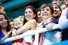 SIGNIFICANT OTHERS Nicole Johnson, fiancee of Michael Phelps of the United States, holds their son Boomer and Debbie Phelps, Michael's mother, celebrate after the Men's 4 x 100m Medley Relay Final on Aug. 13. Phelps Family - Adam Pretty/Getty Images