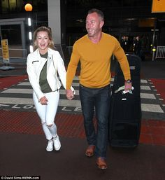 Homeward bound:Ola Jordan was delighted to be back in England on Wednesday with husband James after the ultimate culture shock on I'm A Celebrity... Get Me Out Of Here!