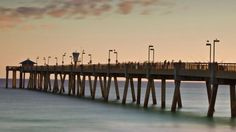 Watch the sun set or fish from the pier of Okaloosa Island, where locals and tourists also flock to the island for the white-sand beaches. #DestinFl #vacation #fishing
