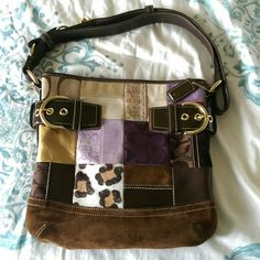 Coach Patchwork Hand Bag This unique and fun purse features different Coach patch designs focusing on hues of purple , brown, and tan. The interior is free from stains and tears. The exterior does not have any apparent stains or damages just normal signs of wear but upkept in great condition. Truely a classic. Coach Bags Shoulder Bags