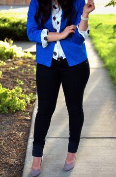 polka dot blouse, black pants and cobalt blue jacket