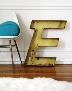 Vintage Drive-in Metal Channel Letter E: Italic E. Wonder if we can find an L